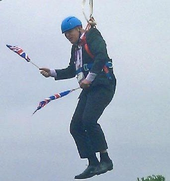 This mobile phone photo provided by Lee Medcalf shows Boris Johnson, the mayor of London, dangling in midair above the crowds at an open-air viewing site at east Londonís Victoria Park, on Wednesday, Aug. 1, 2012. (AP Photo/Lee Medcalf)