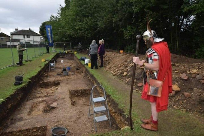 Roman Soldier looking into Archaeological Trench Petuaria ReVistied 2020 Courtesy of Petuaria Revisited Project